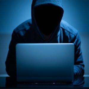 Hacker at computer