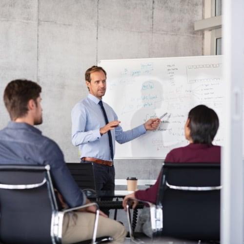 Business Man discussing metrics